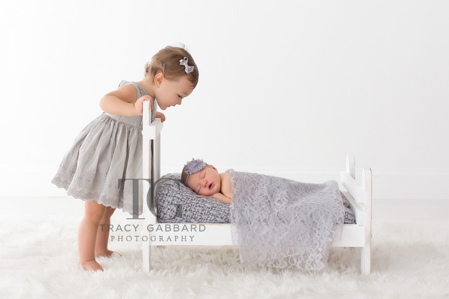Tampa Newborn Photographer I'm so excited to share with you all this super sweet newborn session. As a Tampa Newborn Photographer, I had so much photographing big sister (every since she was a newborn) but especially now with her newborn little sister on the scene! Can't wait to photograph little sister when she starts crawling! This is one of my favorite families to photograph :) Tampa Newborn Photographer